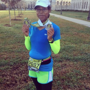 Posing with my medals.  I did the Cypress 5K and the Louisiana Half Marathon that weekend.